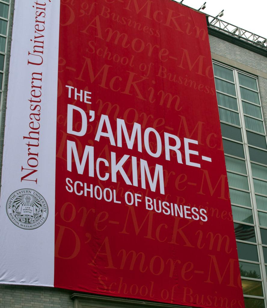 A D'Amore-McKim School of Business banner hanging on Dodge Hall. News Staff Photo/Matt Greene