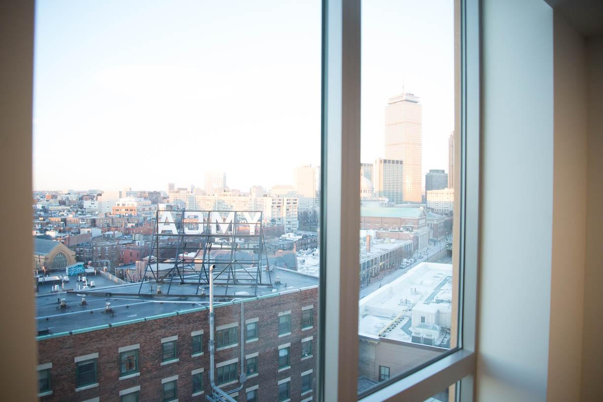 The+sun+sets+on+downtown+Boston.+The+view+from+the+upper+levels+of+East+Village+allows+people+to+see+Boston%2C+along+with+the+sign+atop+the+Huntington+Avenue+YMCA.