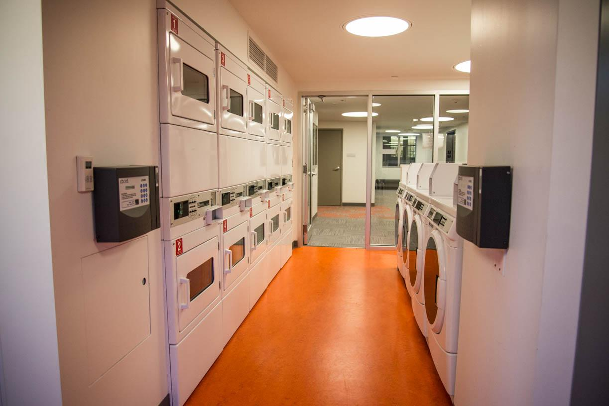 There+are+laundry+machines+on+the+second+floor+of+East+Village.+The+dorm+opened+this+month+offers+laundry+machines%2C+a+bike+room+on+the+first+floor+and+a+conference+room+on+the+17th+floor.+