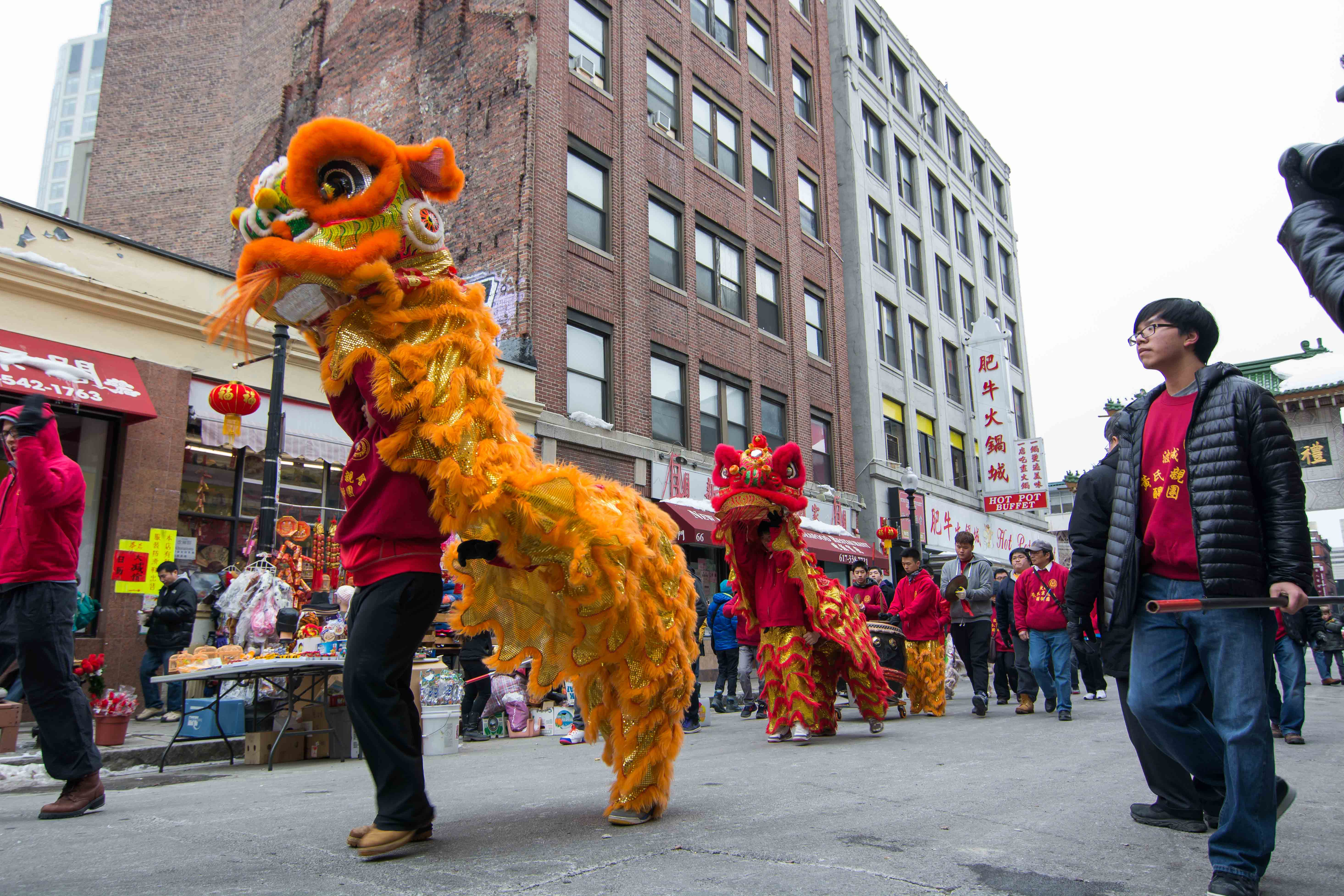 A line of lion dancers walk down Beach Street in Boston, where the majority of the celebration is held.
