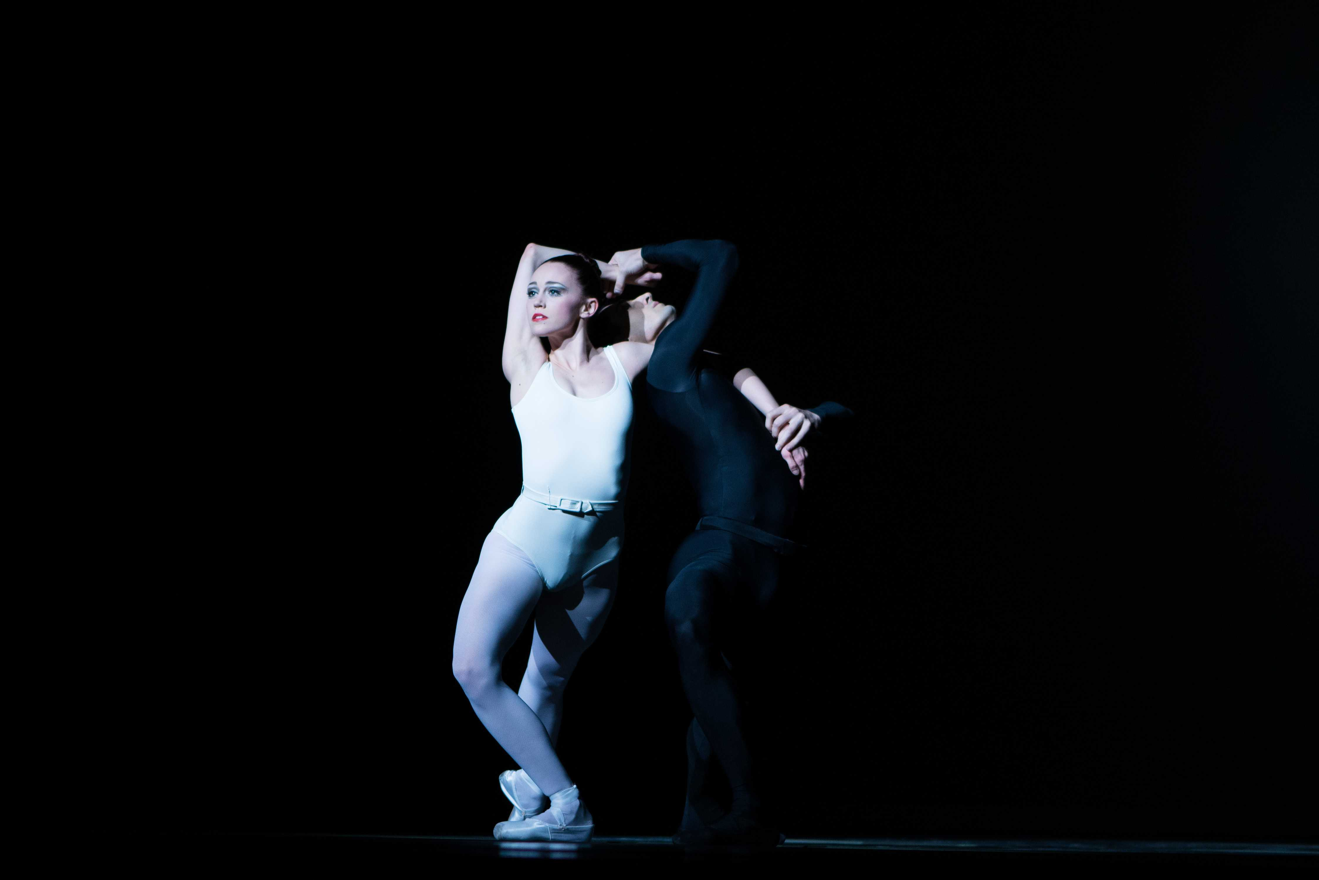 Lasha Khozashvili and Dusty Button perform on stage.