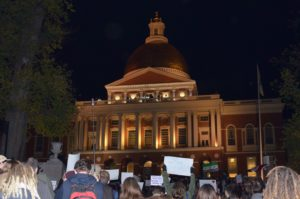 Citizens, students protest Baker's refugee position