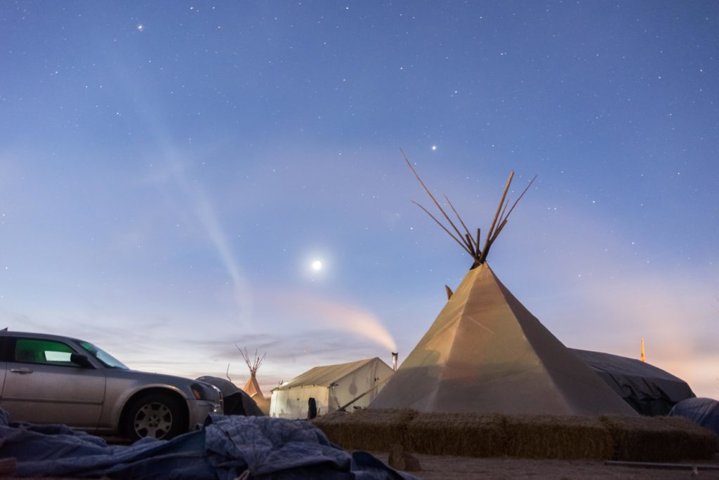 The+stars+begin+to+fade+at+Oceti+Sakowin+Camp+in+the+early+morning+of+Saturday%2C+Nov.+26.+The+temperature+was+around+16+degrees+Fahrenheit+before+the+sun+rose.
