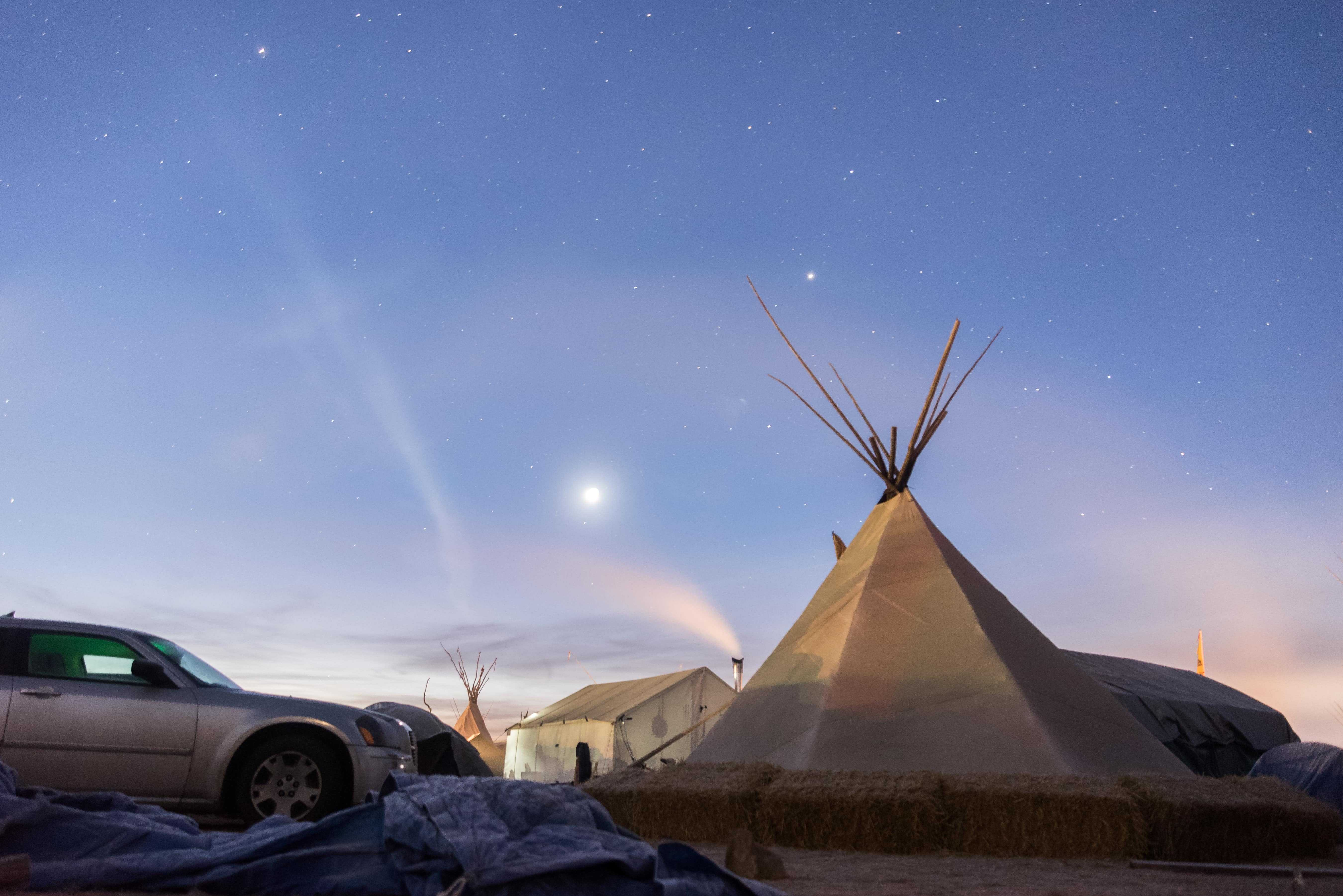 The stars begin to fade at Oceti Sakowin Camp in the early morning of Saturday, Nov. 26. The temperature was around 16 degrees Fahrenheit before the sun rose.