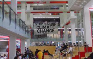 DivestNU unveils banner for national day of action