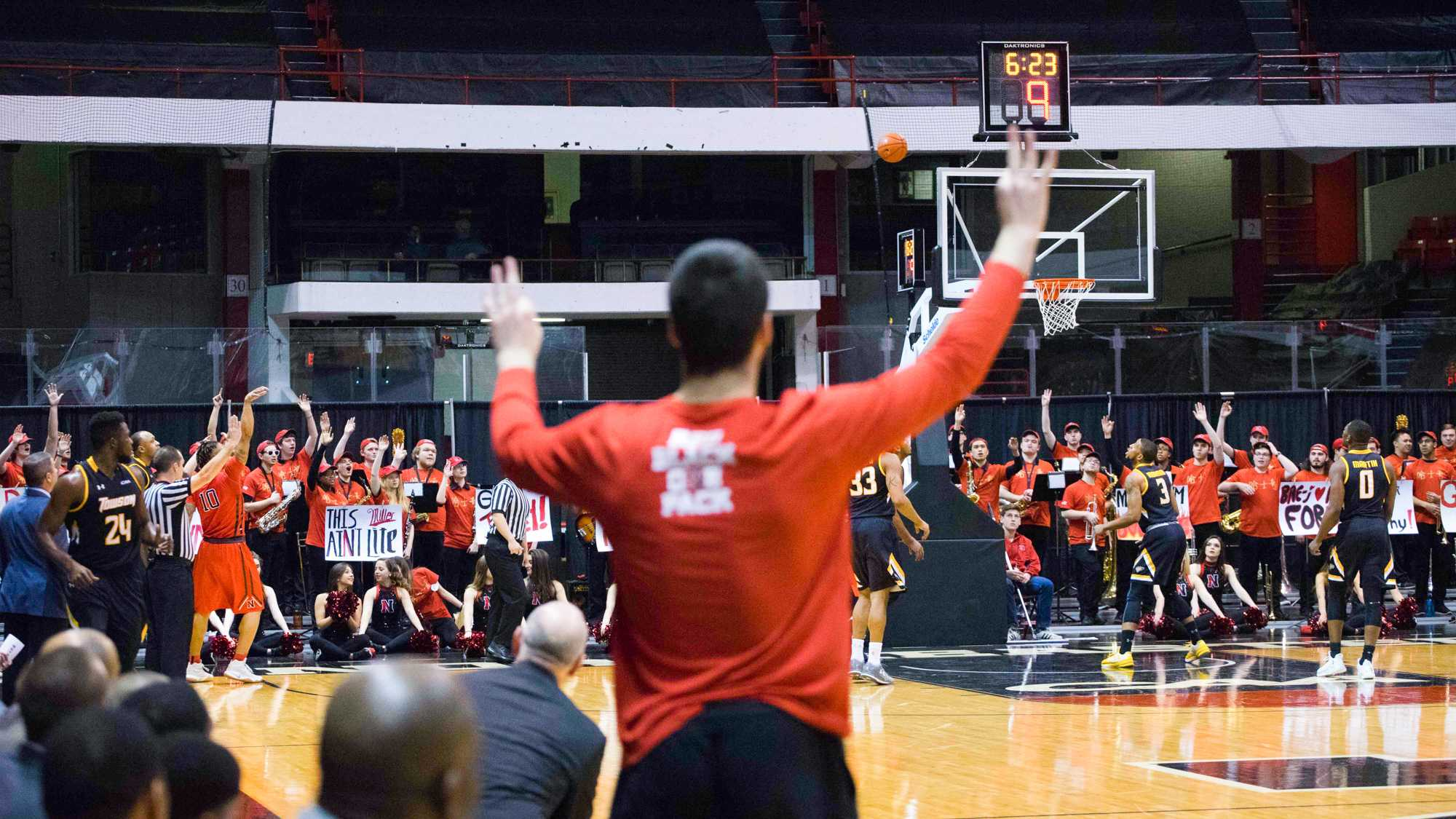 The+crowd+cheers+as+senior+T.J.+Williams+%2810%29+shoots+a+3-pointer+during+the+first+half.