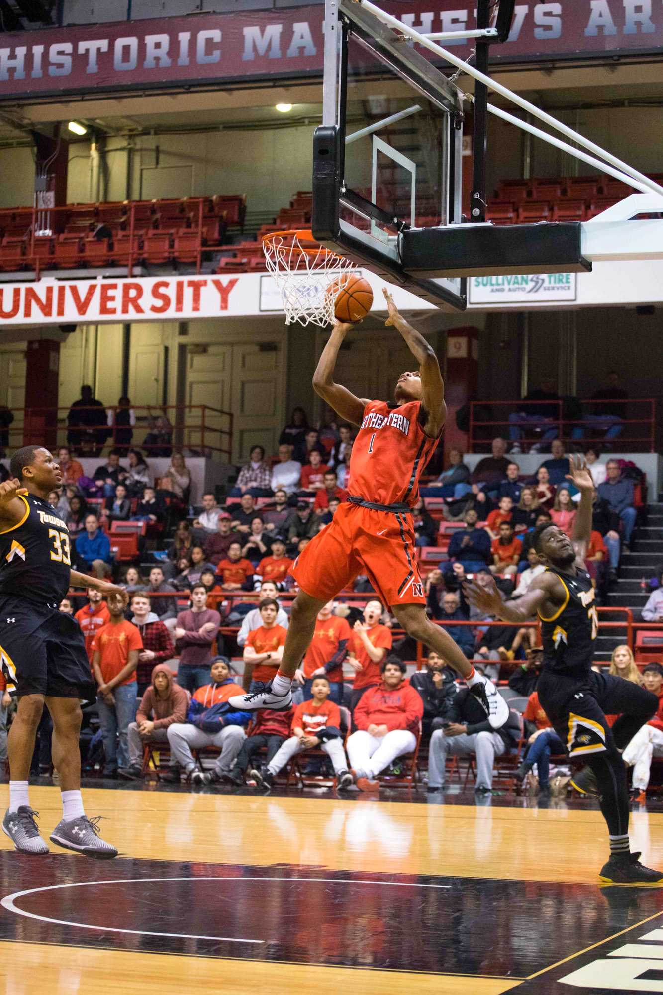 With+under+a+minute+to+play%2C+freshman+Shawn+Occeus+%281%29+draws+a+foul+during+a+layup+attempt+after+a+full-court+breakaway.