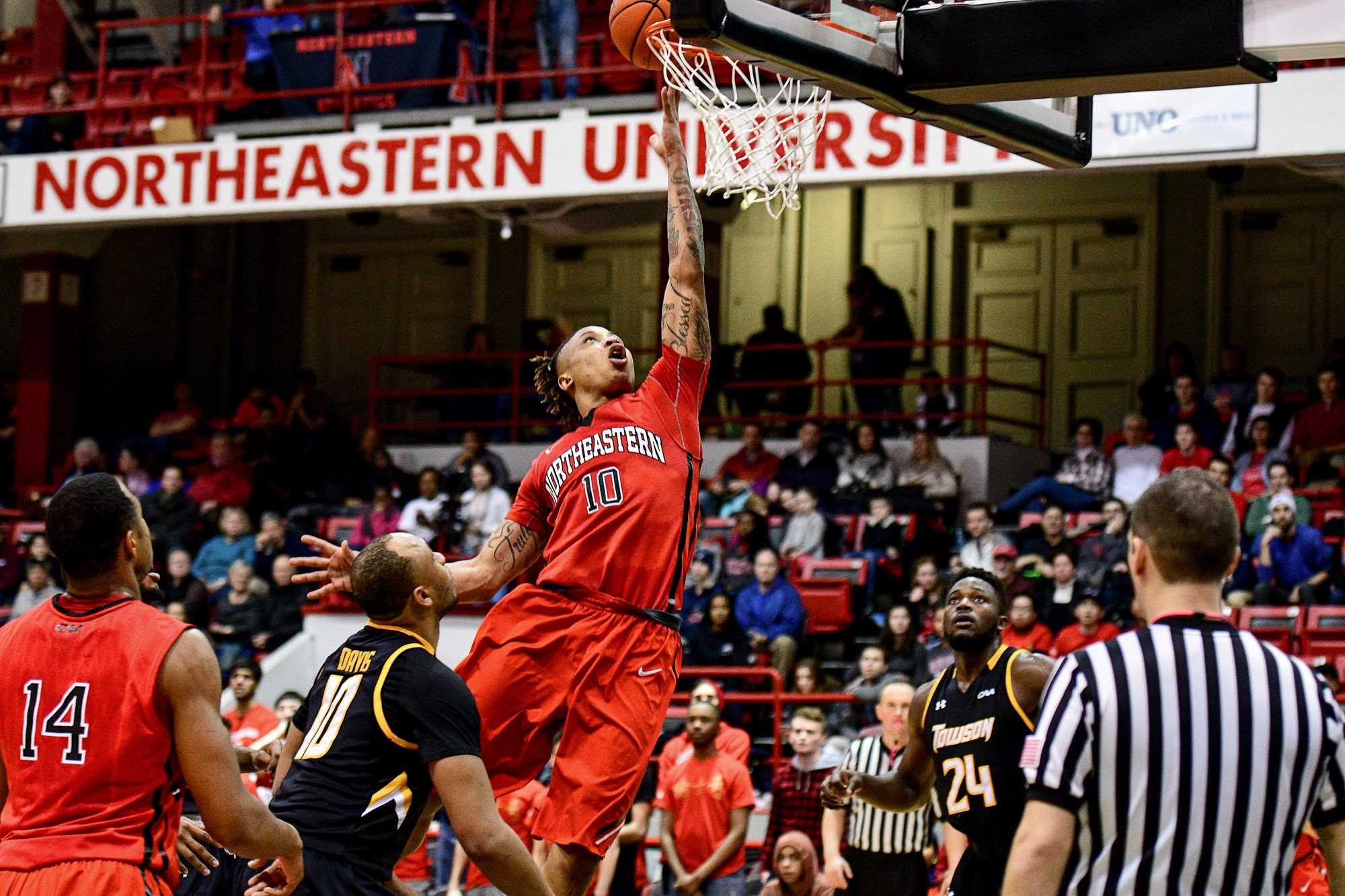 Senior+T.J.+Williams+%2810%29+pushes+forward+to+tip+the+ball+in+during+the+first+half.