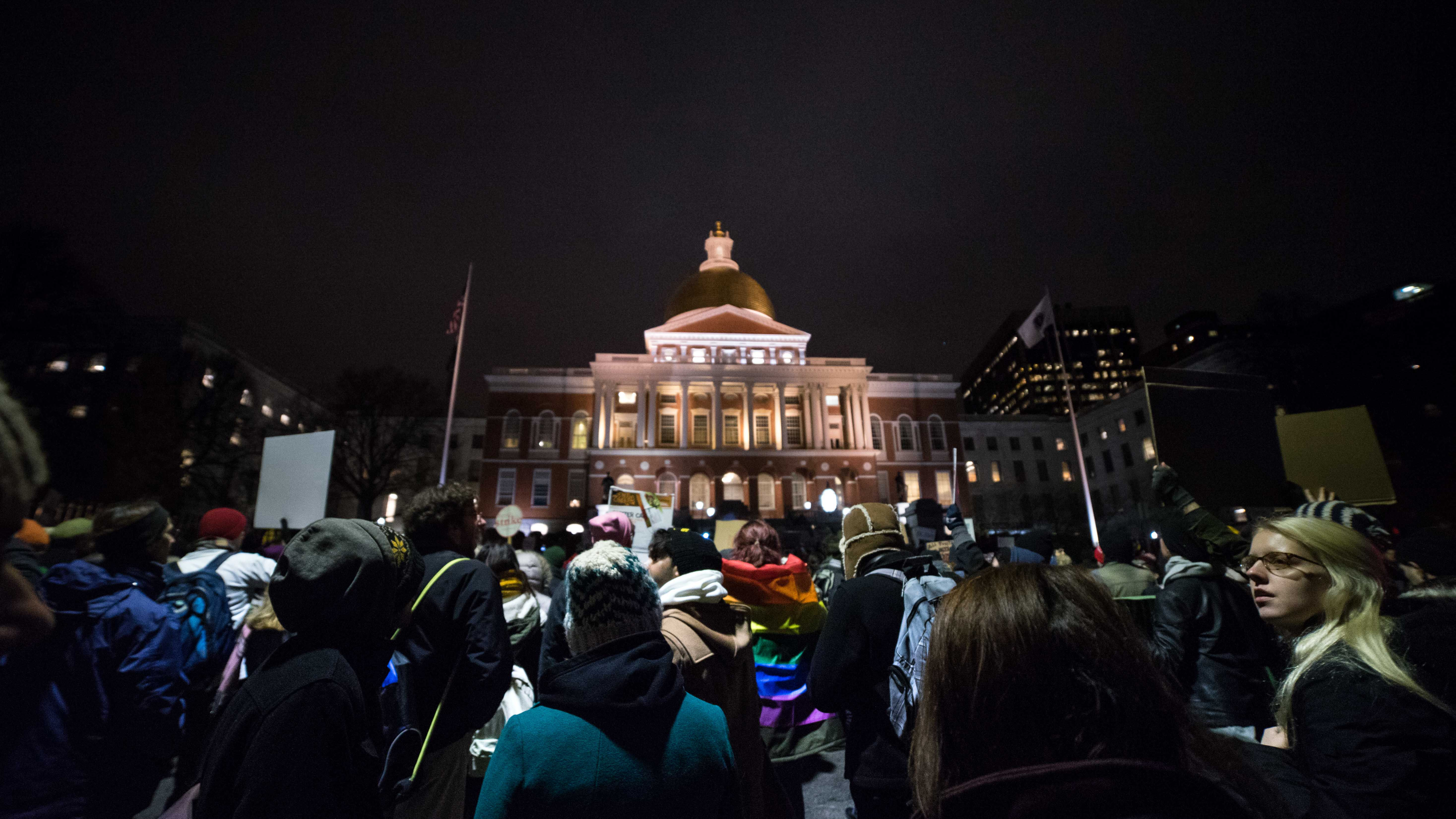 Protestors gather outside the State House around 6:00PM.
