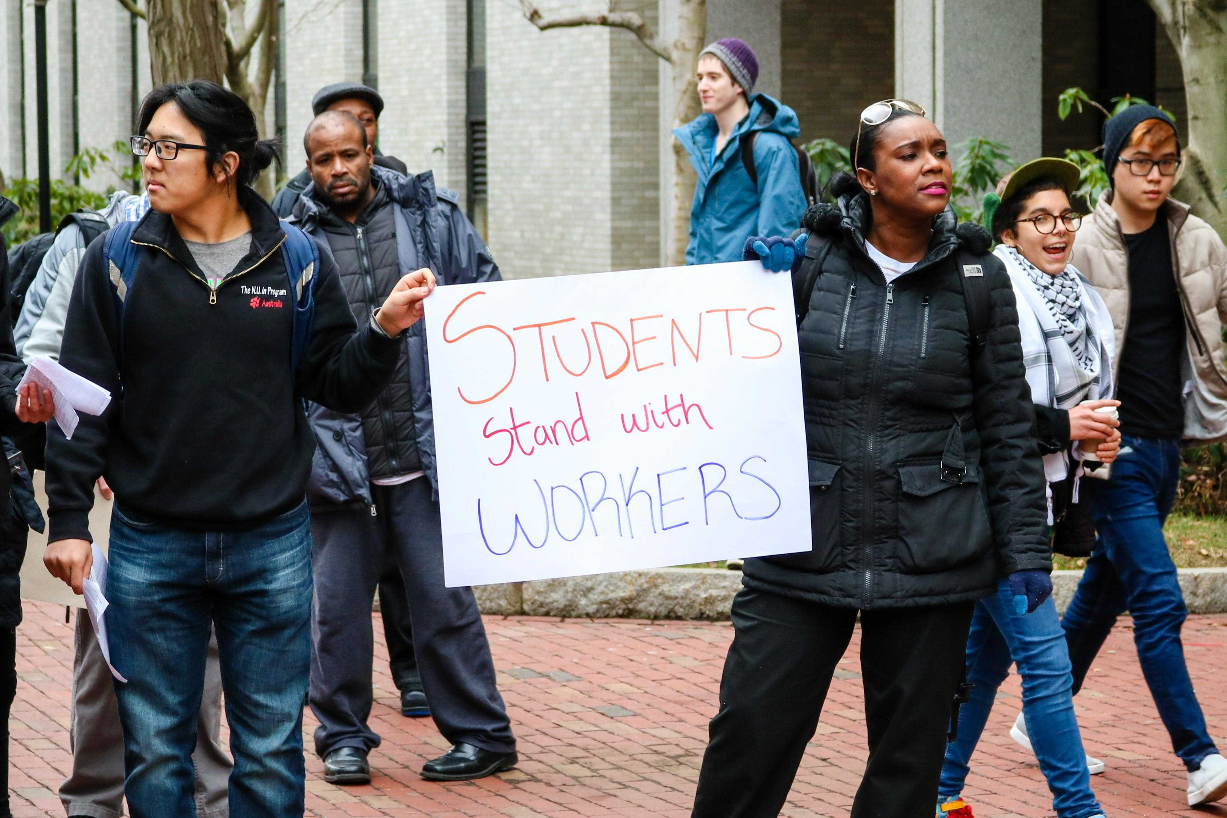 Students+stand+in+solidarity+with+workers+during+the+march+around+campus.