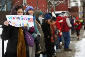 "Hundreds form ""human wall of compassion"" around Roxbury mosque"