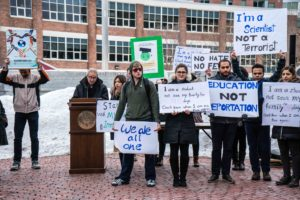 Students, faculty protest immigration ban on Centennial Common