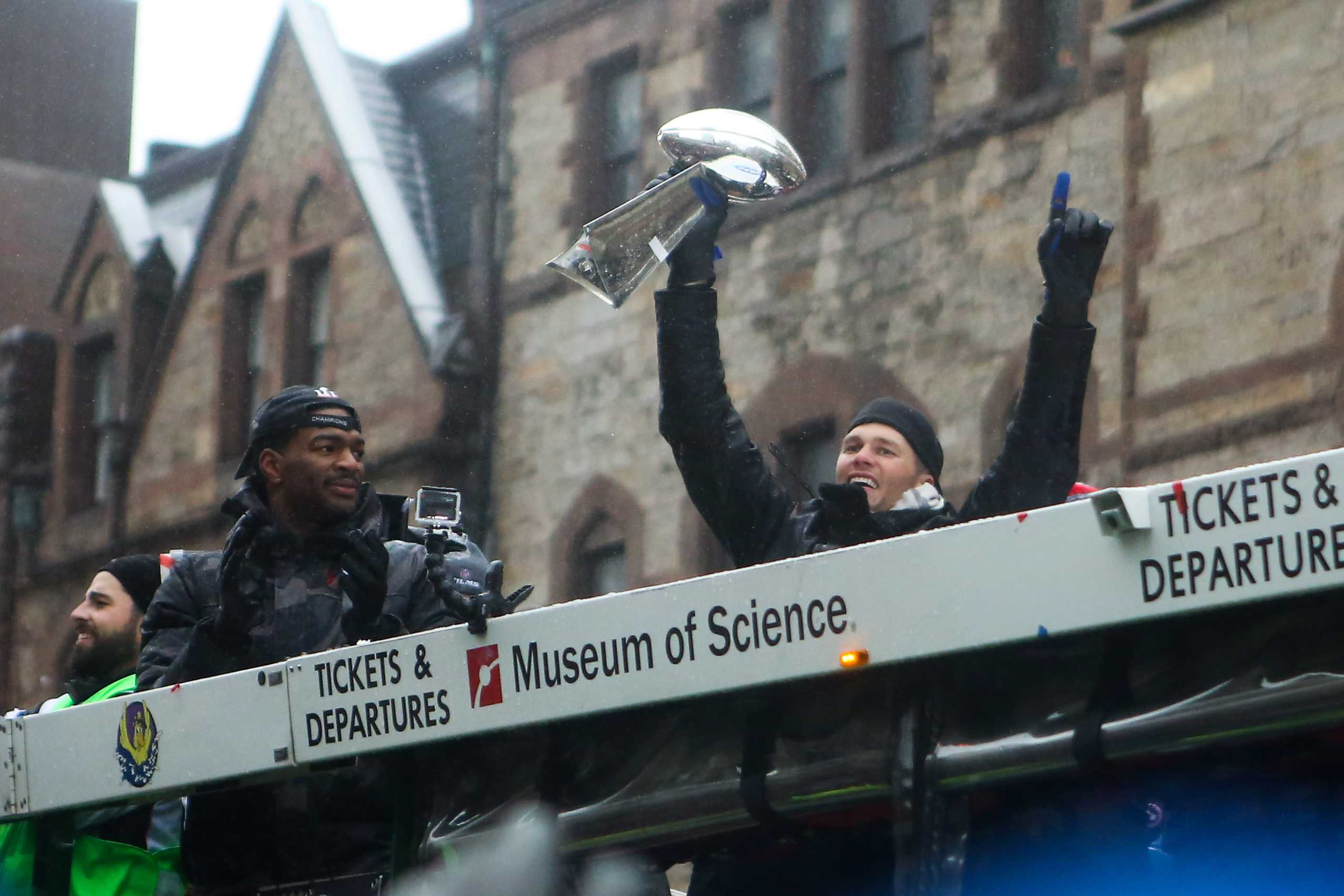 Tom Brady shows off the Vince Lombardi Trophy from Super Bowl LI during the Patriots' Victory Parade.