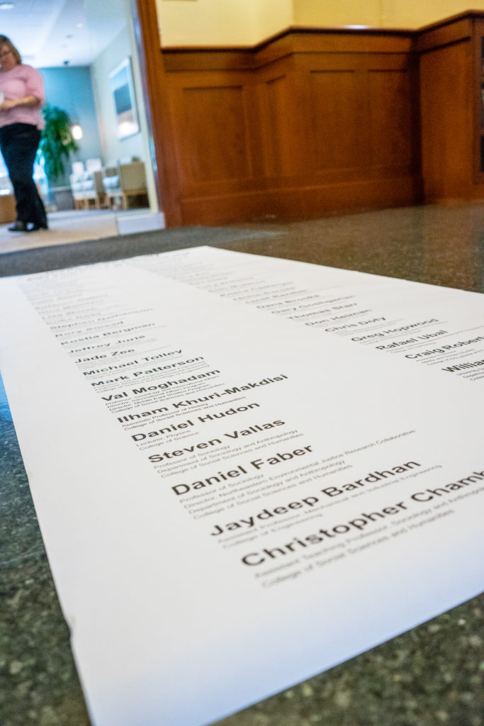 The list of faculty members who signed DivestNU's open letter in support of fossil fuel divestment. The letter was delivered to Provost James C. Bean last fall./Photo by Lauren Scornavacca
