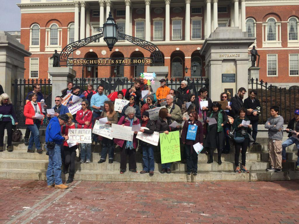 Protestors+gather+in+front+of+the+state+house+to+urge+Gov.+Baker+to+make+Massachusetts+a+sanctuary+state+for+undocumented+immigrants.+%2F+File+photo+by+Ryan+Grewal