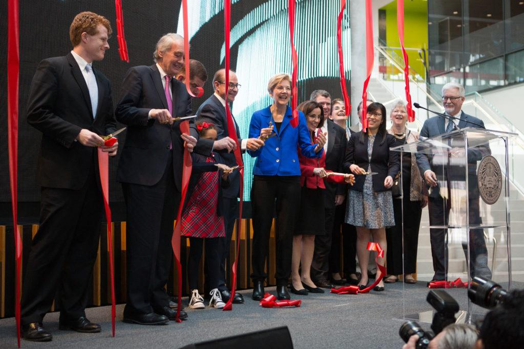 Guest+speakers+and+Northeastern+faculty+cut+red+ribbons+in+a+symbolic+ribbon-cutting+ceremony+to+celebrate+the+opening+of+the+ISEC.+%2F+Photo+by+Dylan+Shen