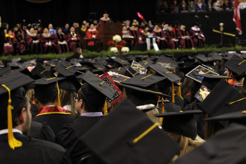 Graduating seniors watch the commencement ceremony.