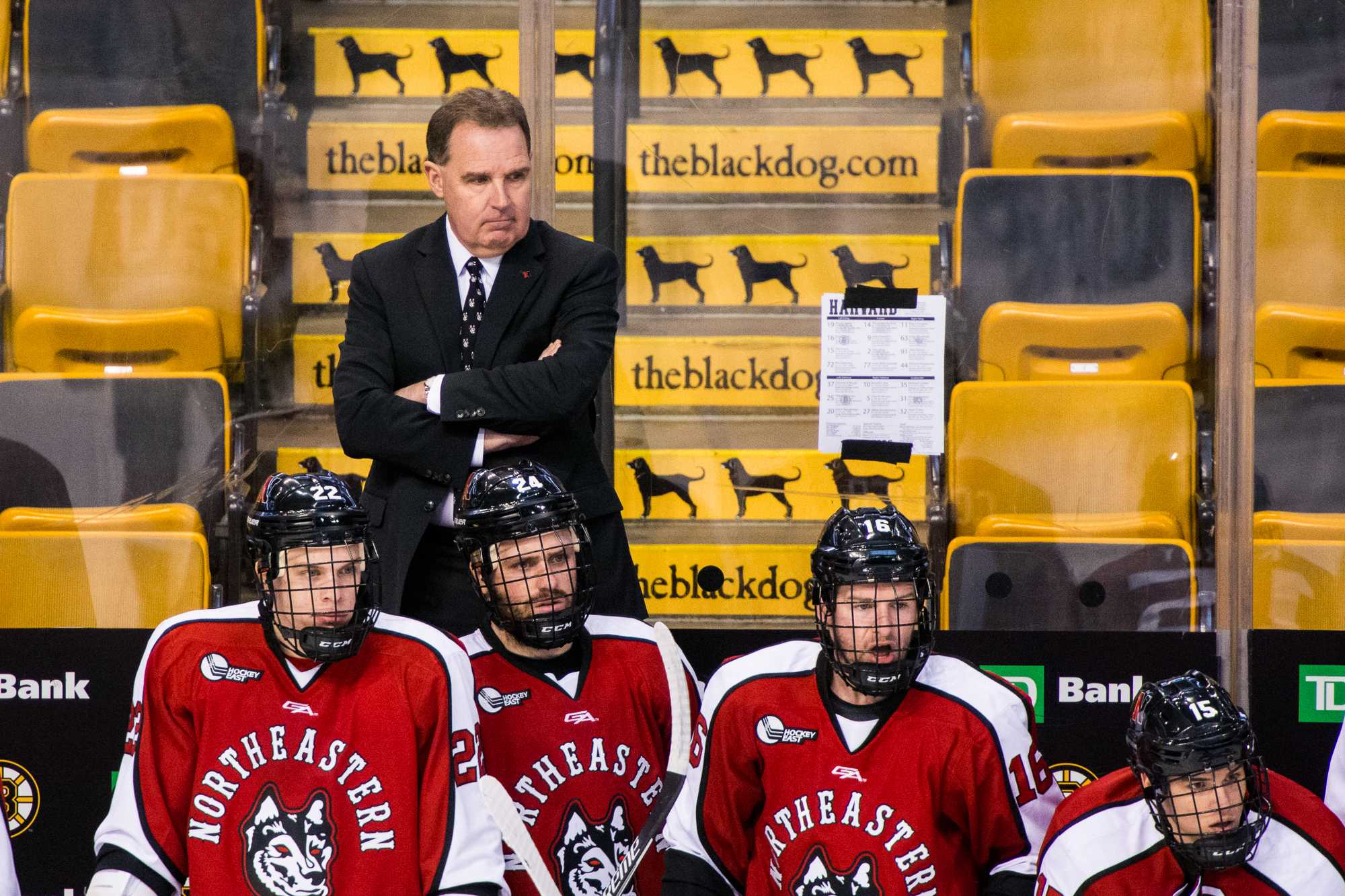 Northeastern head coach Jim Madigan stands behind the bench in 2017 at TD Garden, where he hopes NU students will turn out in droves for the 2019 Beanpot.