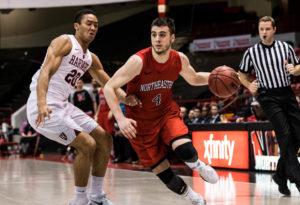 Pusica stars as Northeastern downs Harvard 77-61