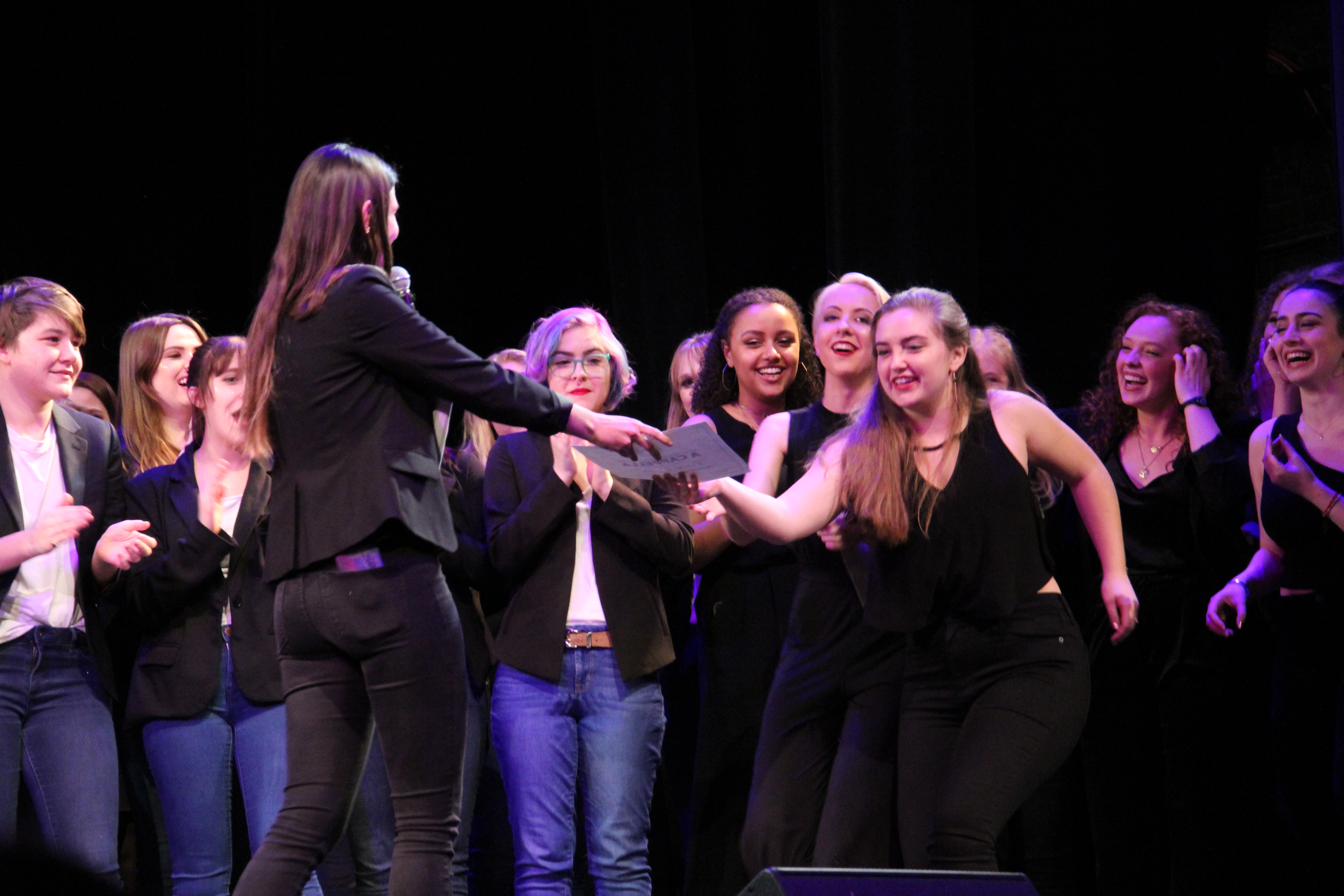 Katie Ryan, member of Pitch, Please!, one of Northeastern's a cappella groups, accepts the award for Best Choreography at the ICCA quarterfinals. / Photo by Sam Cronin