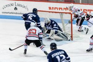 Men's hockey pulls 8-0 victory on senior night