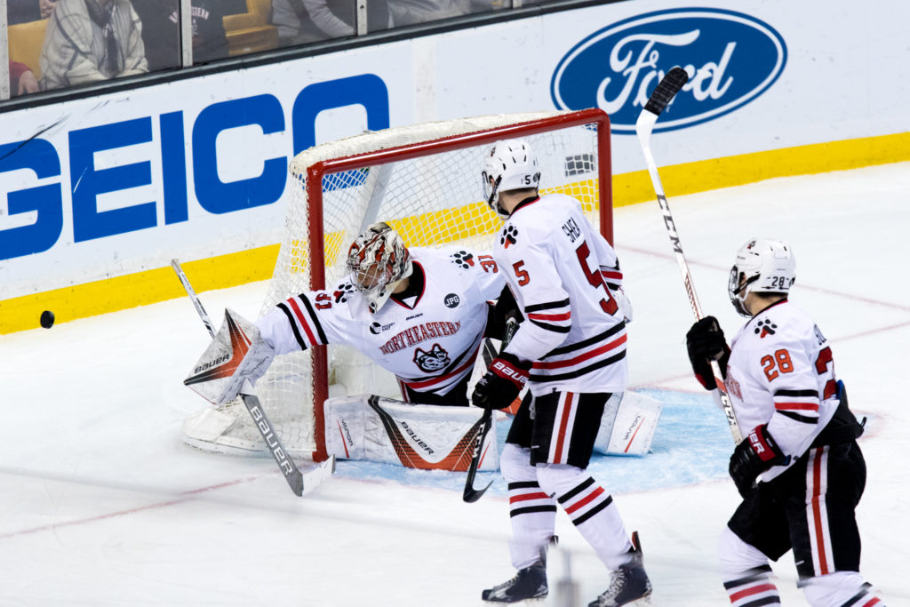 Defenseman Ryan Shea watches as Cayden Primeau makes a save during the Hockey East Semis last year.