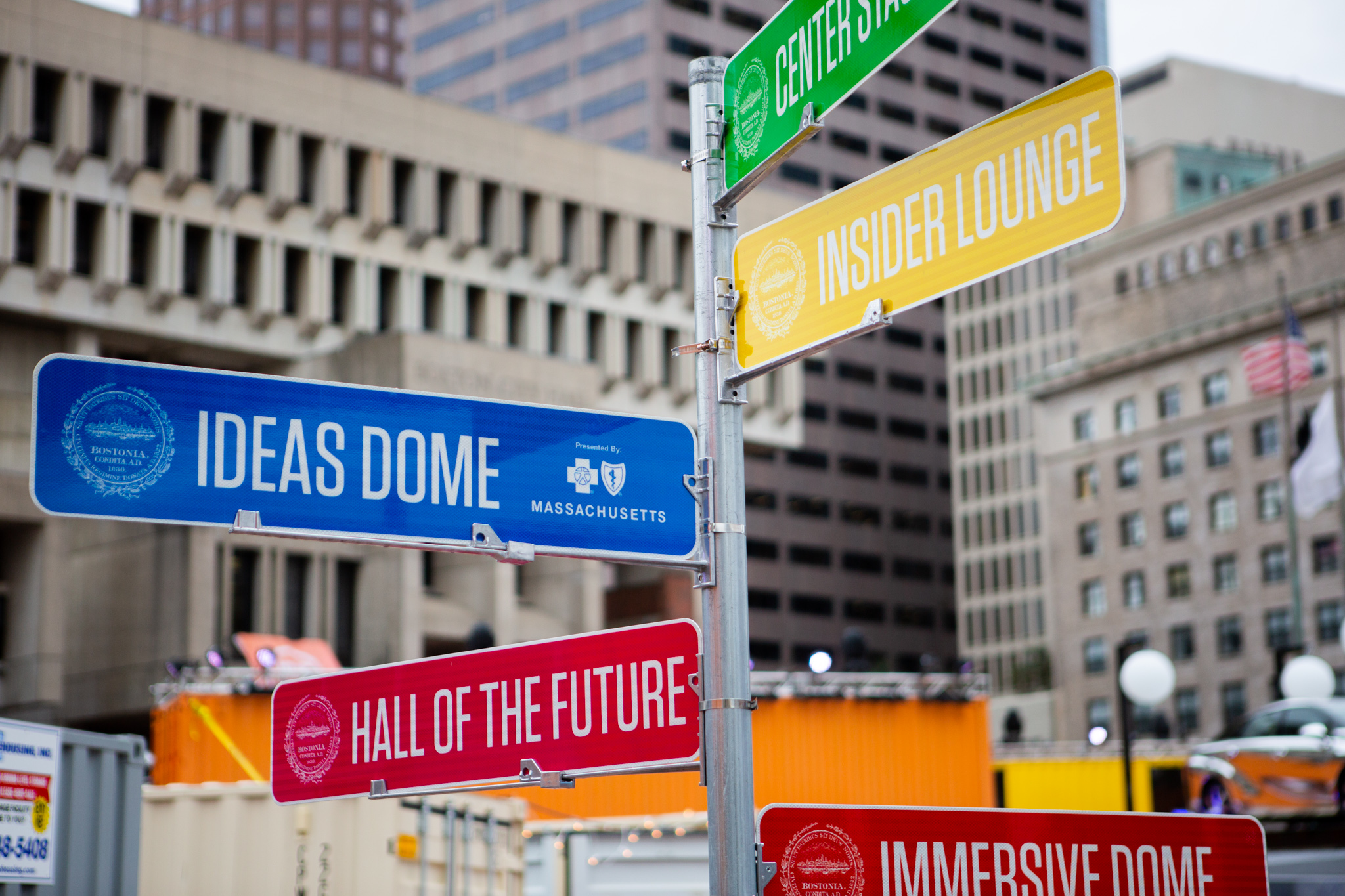 A central signpost within the HUBWeek complex directs attendees to exhibits around City Hall Plaza. / Photo by Dylan Shen