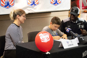 Men's soccer signs 8-year-old cancer patient