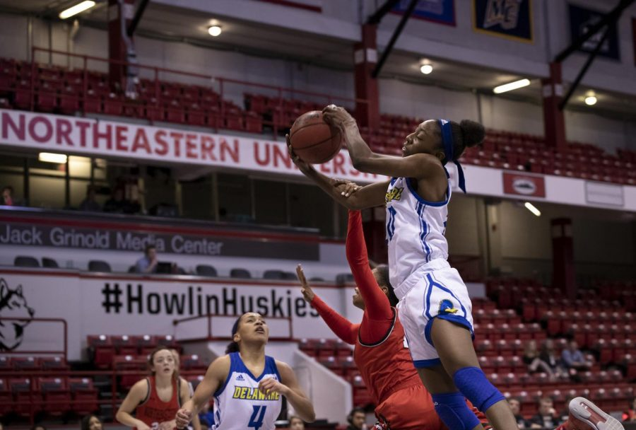 A Northeastern player and a Delaware player grapple for the ball in a prior game.