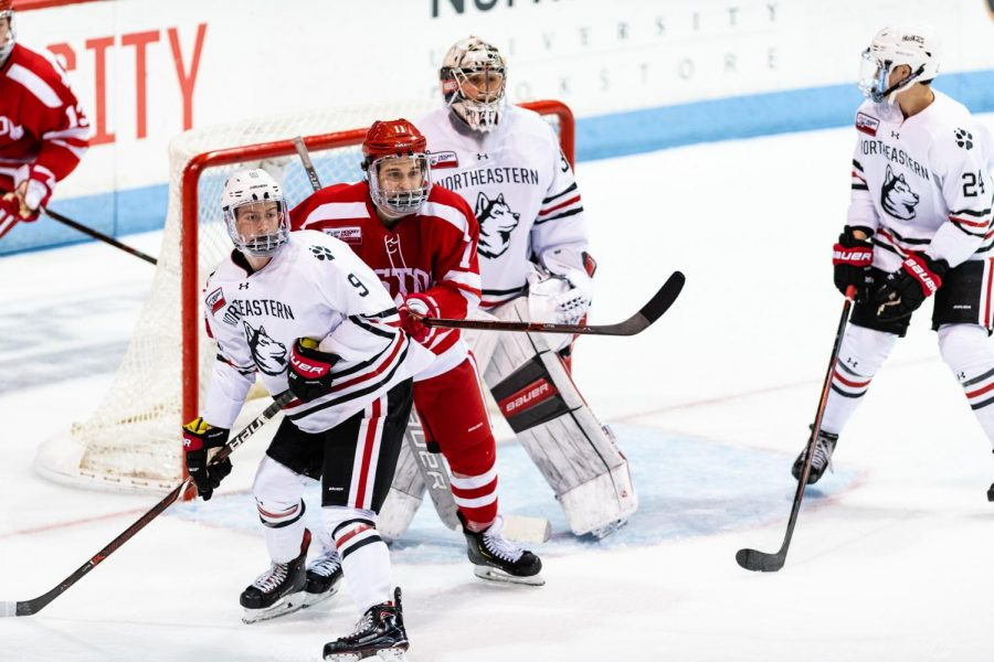 Freshman forward Tyler Madden, sophomore goalkeeper Cayden Primeau, and freshman defender AJ Villella defend their net during a prior game against Boston University. / Photo courtesy of Brian Bae, Red and Black.