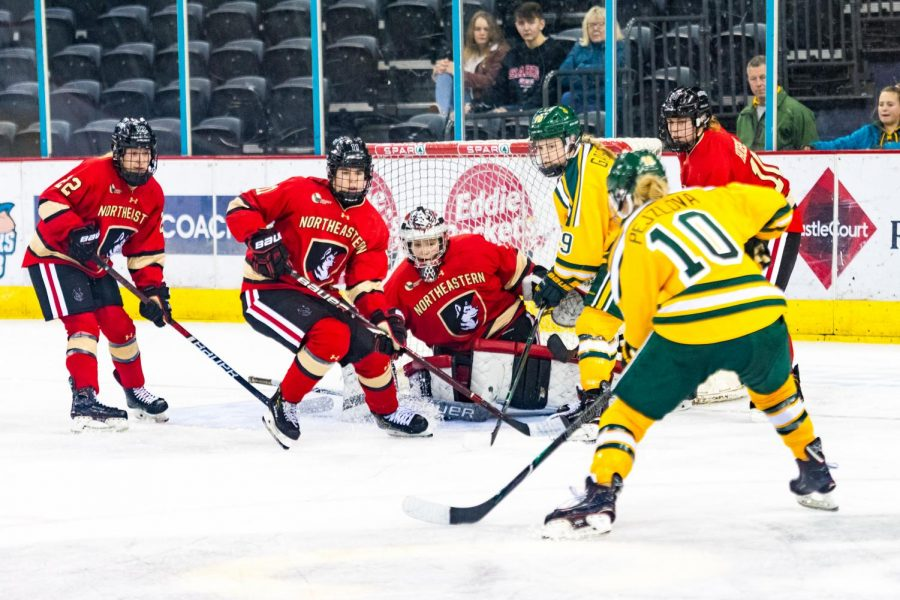 Fontaine, forward Alina Mueller, goalkeeper Aerin Frankel, and Hobson (left to right) defend their net during a prior game against Clarkson in Belfast, Northern Ireland.