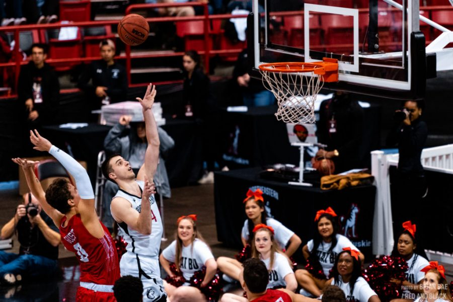 Redshirt senior guard Vasa Pusica puts up a shot in traffic in a prior game against Boston University. / File photo by Brian Bae.