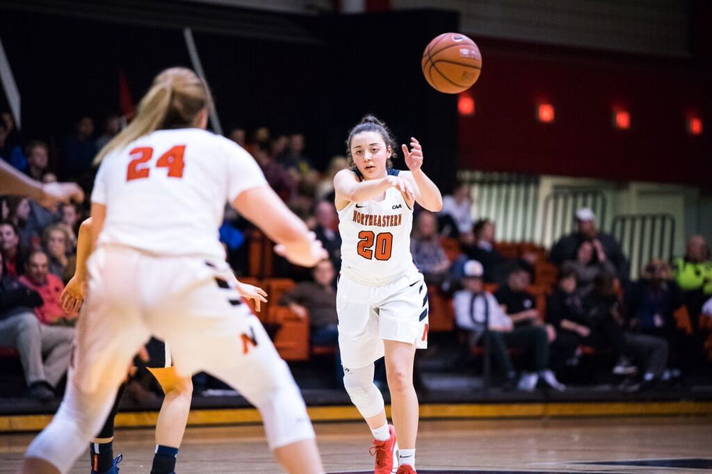 Senior guard Jess Genco passes the ball during a game last season. / File photo by Alex Melagrano.