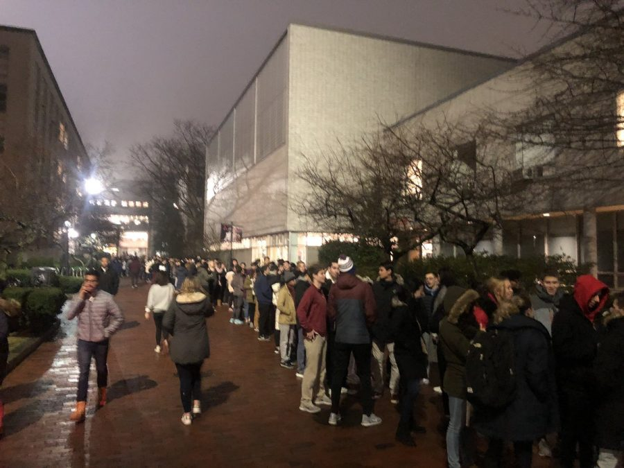 Dozens+of+students+wait+in+line+to+enter+the+Cabot+Center+and+take+part+in+the+winter+involvement+fair.