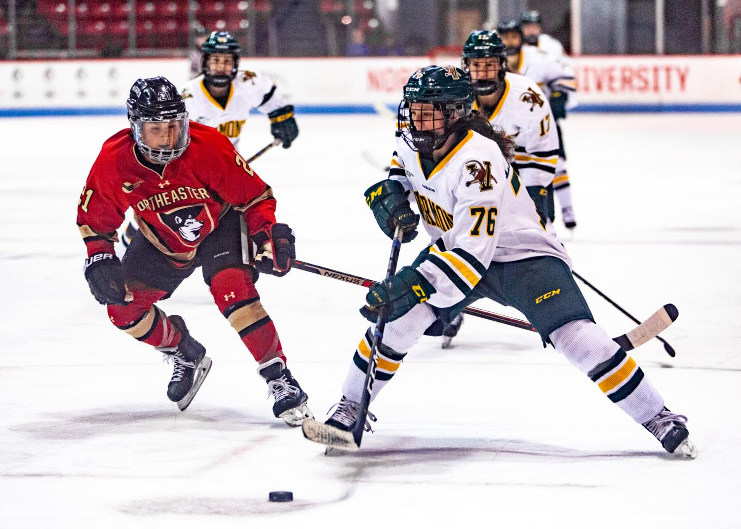 Junior defender Paige Capistran pressures Vermont defender Maude Poulin-Labelle as she controls the puck in a prior game. The two teams will face off this weekend in the Hockey East playoffs.