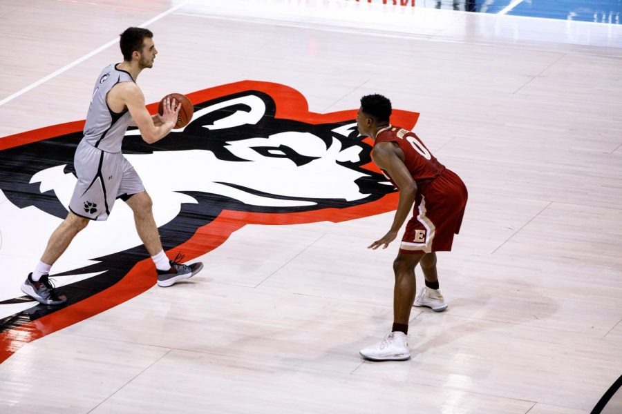 Senior guard Vasa Pusica controls the ball near half-court in prior game against Elon.