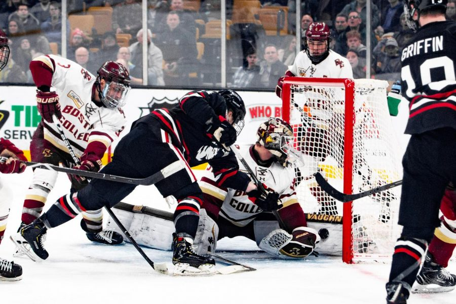 Senior forward Austin Levy scores the first goal in the Beanpot final against Boston College. Plevy is in his first season at NU after transferring from UMass.