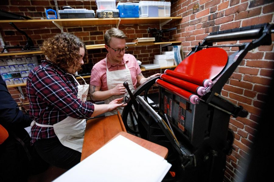 Ryan Cordell, the director of Huskiana Press, shows off the printing press Feb. 12.