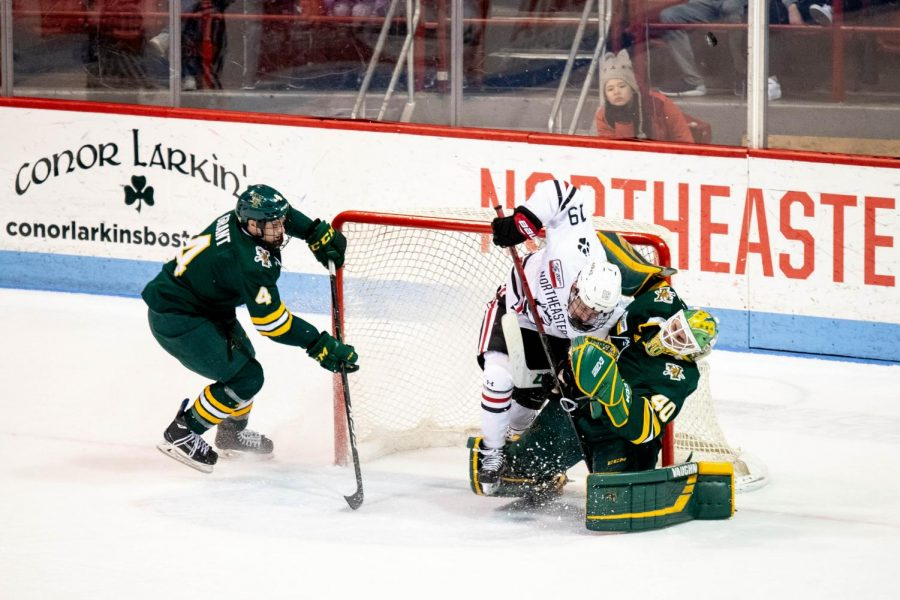 Lincoln Griffin crashes into UVM netminder Stefanos Lekkas, earning a two-minute minor penalty for charging.