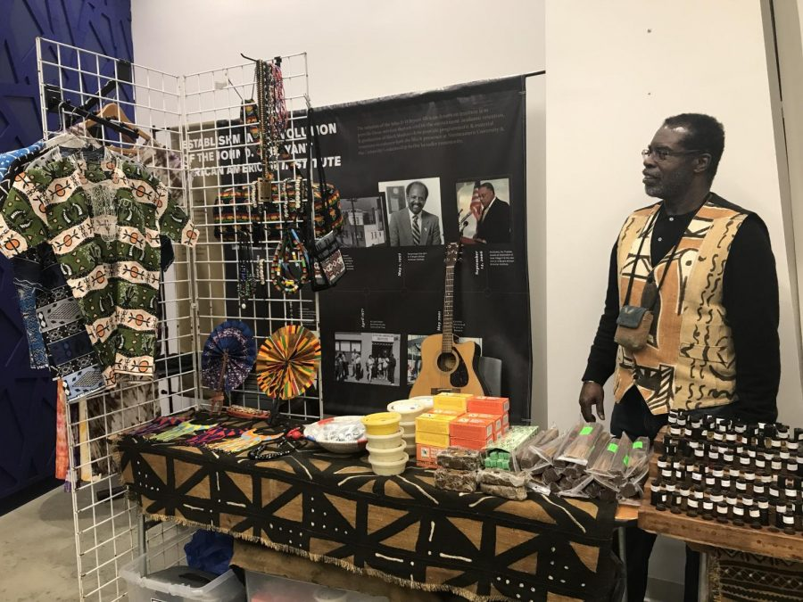 Rickie+Thompson%2C+co-founder+of+Prime+Taste+of+Africa%2C+sells+his+Afrocentric+merchandise+at+the+NU+Black+Market+event.