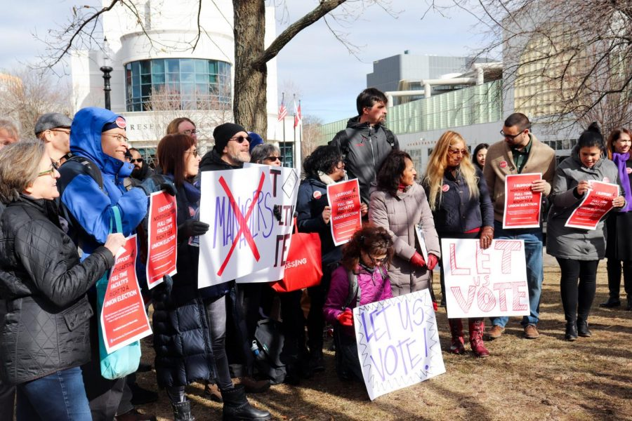 NU faculty members hold signs in Centennial Common on Feb. 6 in support of their right to hold a vote.