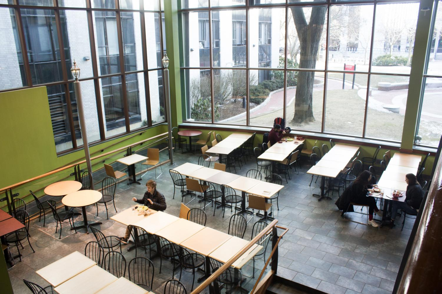 A few students lounge in a corner of one of Northeastern's increasingly expensive dining halls.