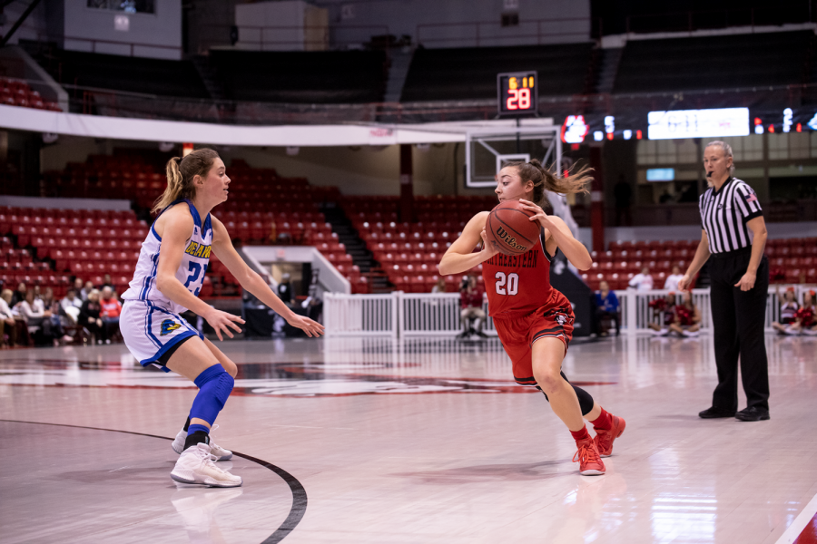 Senior guard Jess Genco looks to drive past a Delaware defender in a prior game.