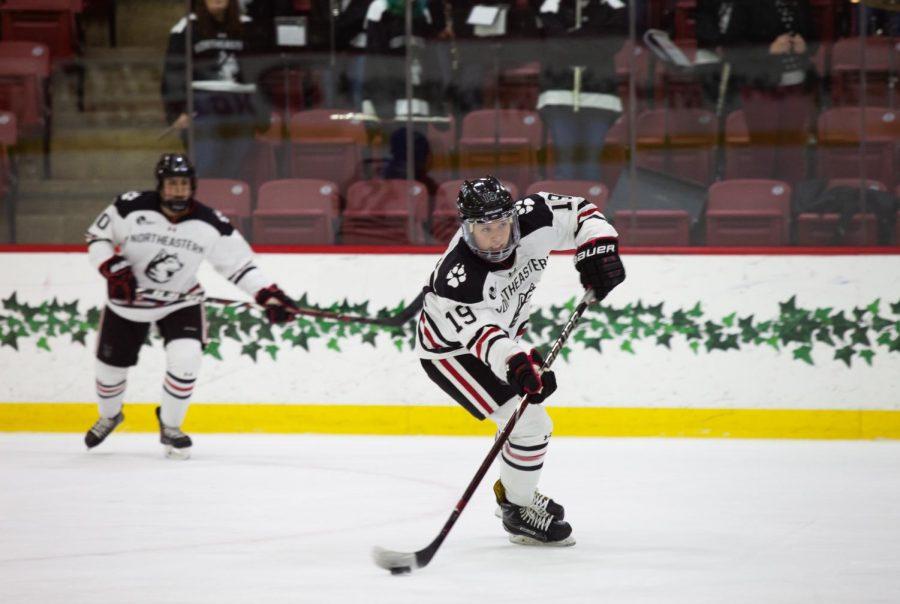 Senior forward Tori Sullivan moves up the ice.