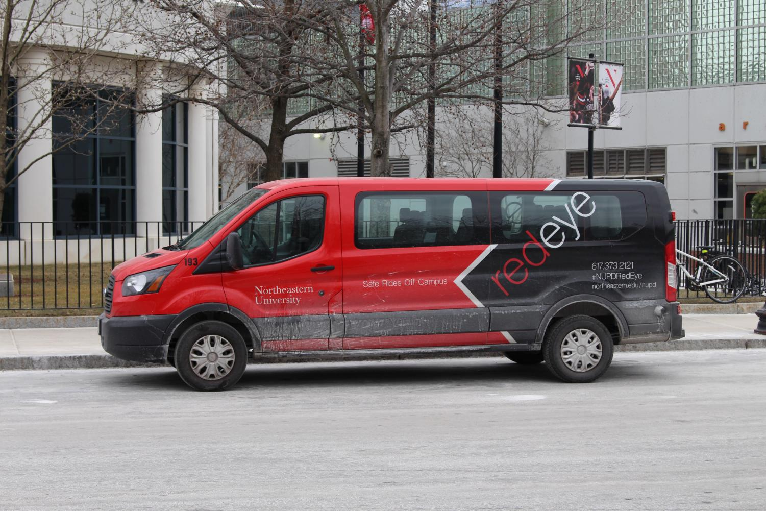 The NU Red Eye van sits in front of Raytheon Amphitheater and offers students safe rides off of campus.