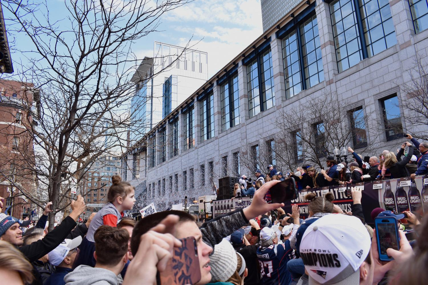 Patriots fans gathered on Boylston Street watch the duck boats go by.