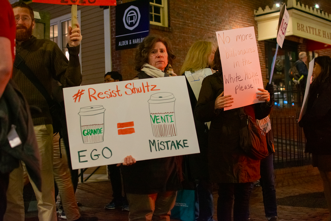Protesters gathered outside the Brattle Theatre in Cambridge Tuesday to protest Howard Schultz's potential presidential run. Among them was Maria Robinson of Cambridge, pictured above.