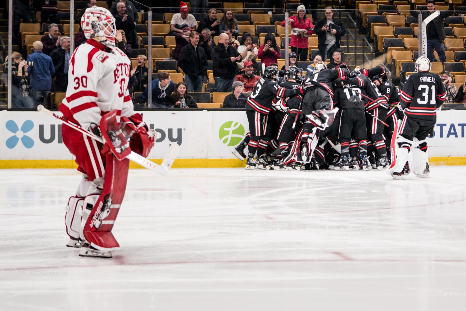 BU goalie Jake Oettinger skates off after the Huskies scored in overtime on their 49th shot. Oettinger's incredible 47 saves weren't enough.