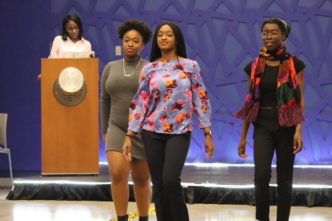 Models display their professional attire at the SIS Co-op Fashion Show.