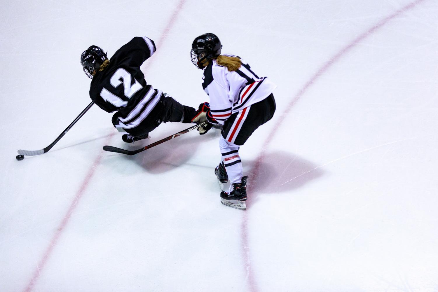 Junior forward Matti Hartman chases a Providence defender in a prior game.